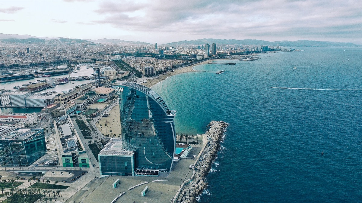 overhead view of the Barcelona beachfront; concept: top SaaS Conferences 2021
