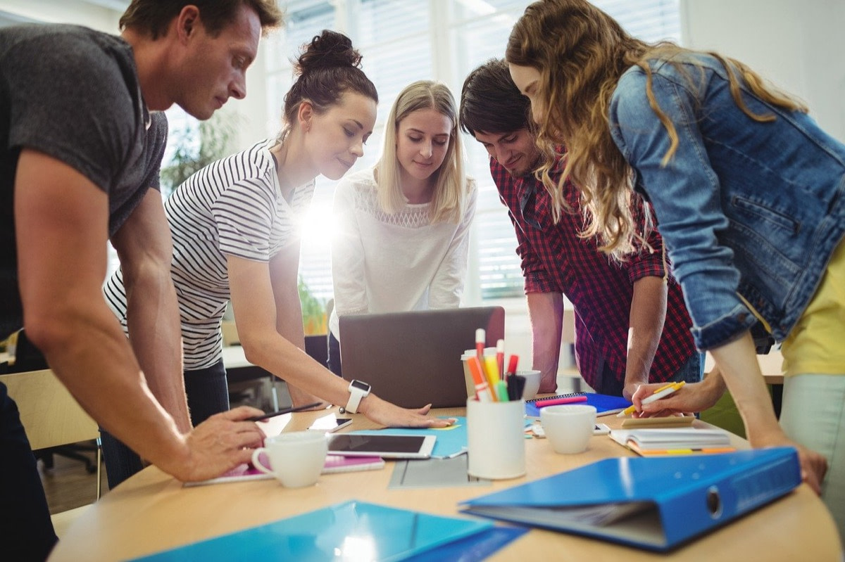 good of workers gather around a table; empathy mapping concept