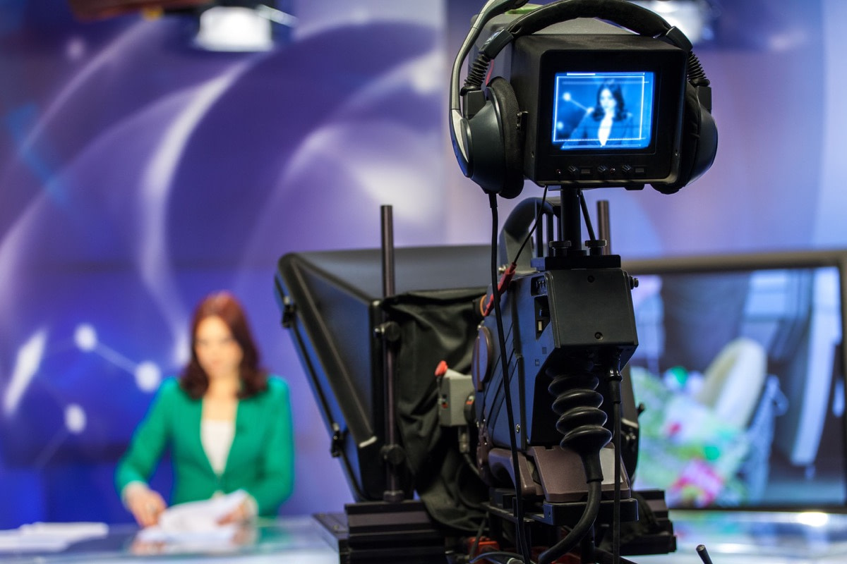 video camera viewfinder - recording show in tv studio - focus on camera; value of the Fourth Estate concept