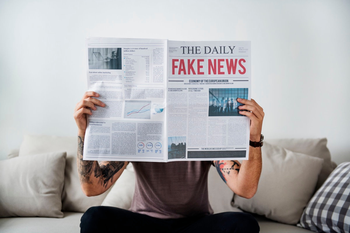Fake news headline on a newspaper; value of the Fourth Estate concept