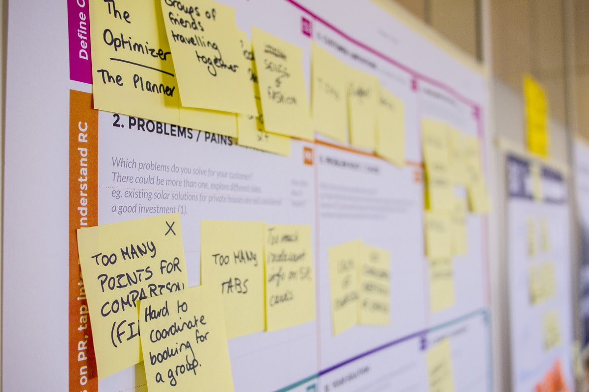 marked up wall calendar covered in sticky notes; bad analytics concept