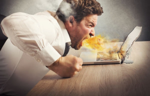Businessman spits fire and melts the computer