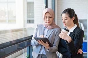 Muslim businesswoman sharing information.