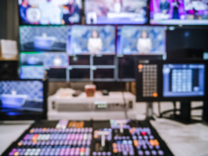 Blur image video switch of Television Broadcast, working with video and audio mixer, control broadcasts in recording studio.